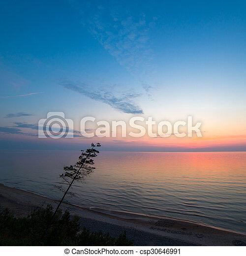 Beautiful Baltic sea coast landscape at sunset - csp30646991