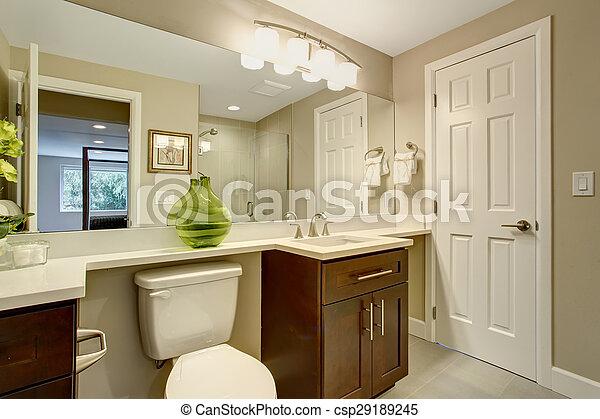Beautiful bathroom with green vase. - csp29189245