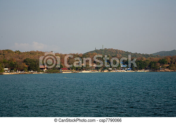 beautiful beach with fine white sand and trees and blue sea in romantic view and blue sky - csp7790066