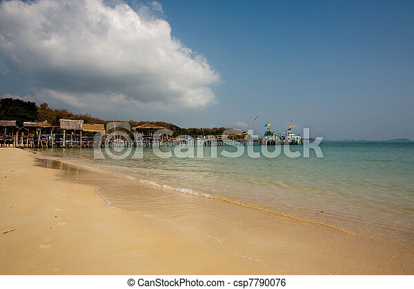 beautiful beach with fine white sand and trees and blue sea in romantic view and blue sky - csp7790076