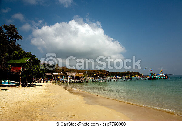 beautiful beach with fine white sand and trees and blue sea in romantic view and blue sky - csp7790080