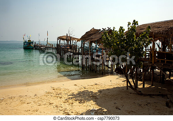 beautiful beach with fine white sand and trees and blue sea in romantic view and blue sky - csp7790073