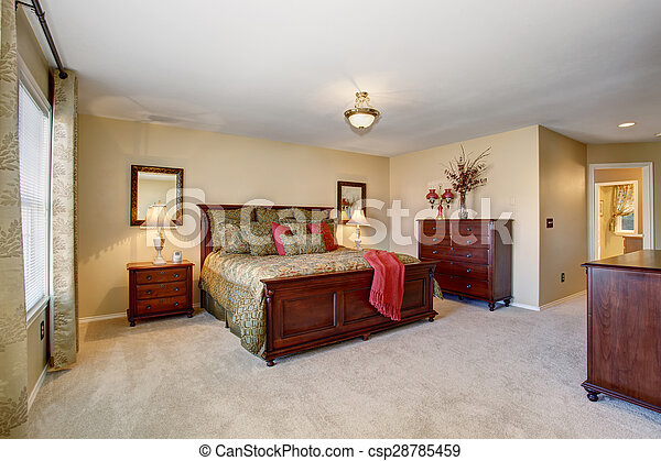 Beautiful bedroom with perfect golden bedding and carpet. - csp28785459