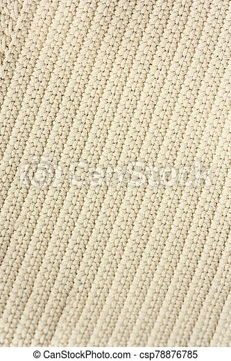 Beautiful beige knitted fabric close up view - csp78876785