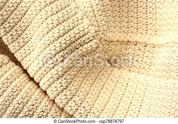 Beautiful beige knitted fabric close up view - csp78876797