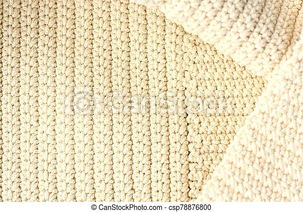 Beautiful beige knitted fabric close up view - csp78876800