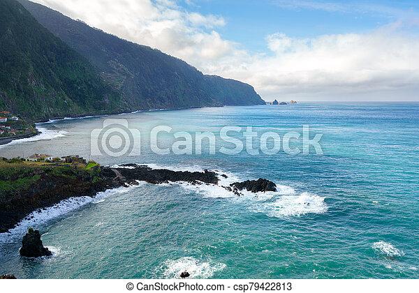 Beautiful black rock beach in Seixal, Madeira with waves crashing - csp79422813
