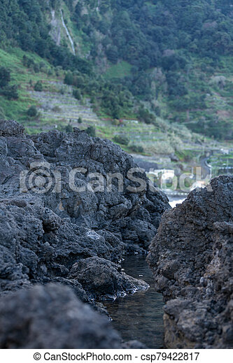 Beautiful black rock beach in Seixal, Madeira with waves crashing - csp79422817