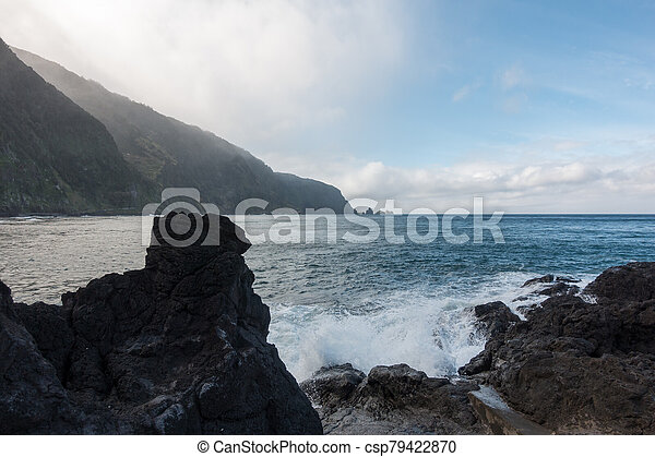 Beautiful black rock beach in Seixal, Madeira with waves crashing - csp79422870