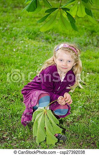 beautiful blond girl in green grass - csp27392038