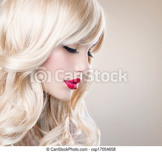 Beautiful Blond  with Healthy Long Wavy Hair. White Hair - csp17054658