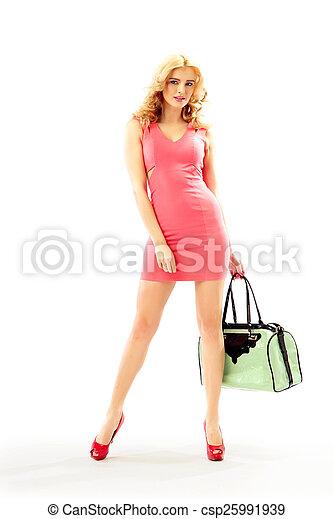 Beautiful blond woman holding a handbag - csp25991939