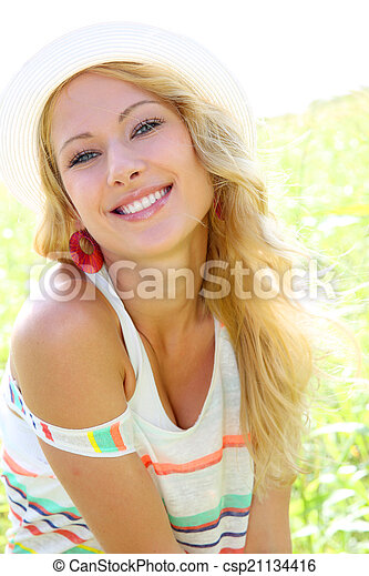 Beautiful blond woman in countryside - csp21134416