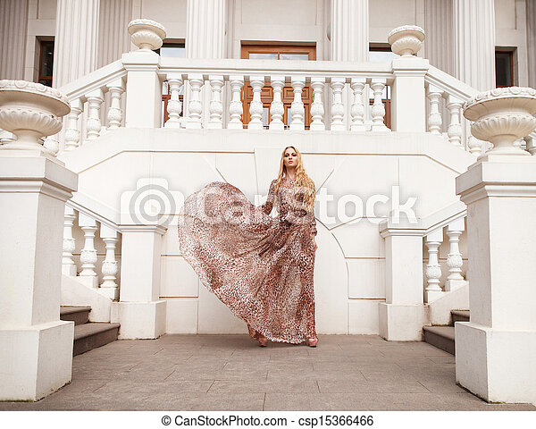 Beautiful blond woman in long dress outdoors - csp15366466