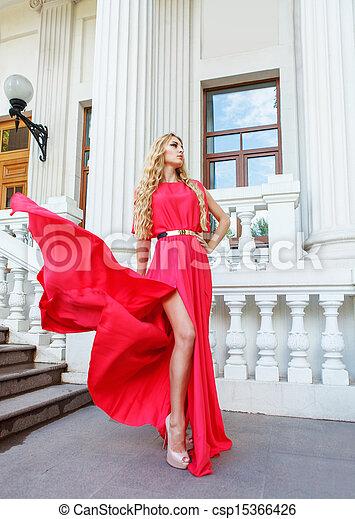 Beautiful blond woman in long dress outdoors - csp15366426