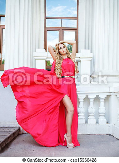 Beautiful blond woman in long dress outdoors - csp15366428