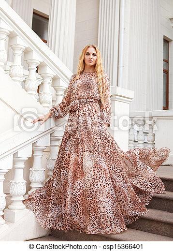 Beautiful blond woman in long dress outdoors - csp15366401