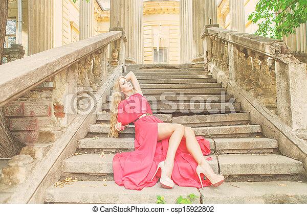 Beautiful blond woman in long dress outdoors - csp15922802