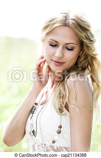 Beautiful blond woman in meadow - csp21134388