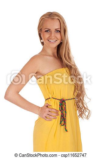Beautiful blond woman in yellow dress - csp11652747