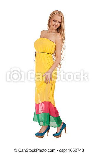 Beautiful blond woman in yellow dress - csp11652748