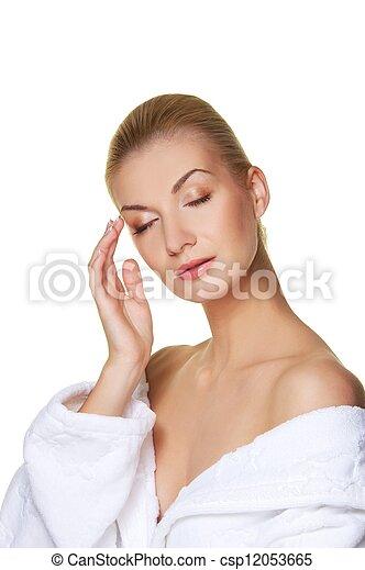 Beautiful blond woman touching her face - csp12053665