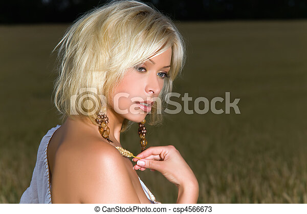 beautiful blonde on a field of wheat - csp4566673