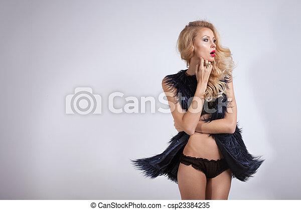 Beautiful blonde woman wearing lingerie - csp23384235