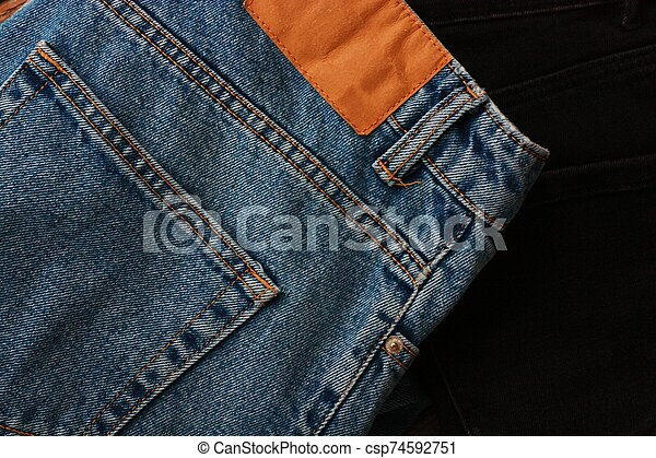 Beautiful blue and black jeans close up - csp74592751