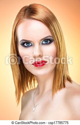 Beautiful blue-eyed woman with extreme makeup - csp17785775