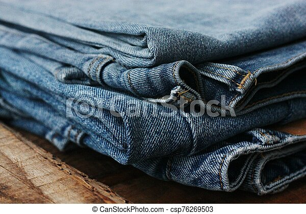 Beautiful blue jeans with pockets close up - csp76269503