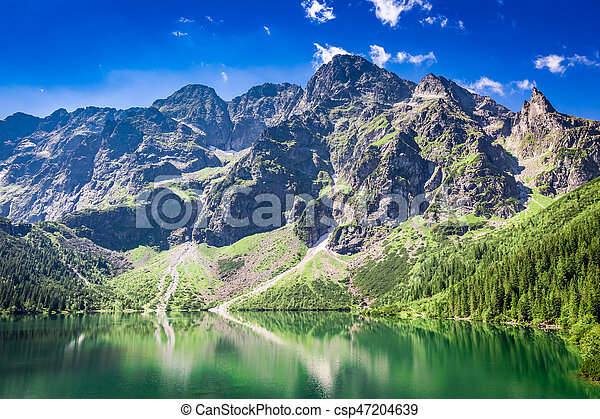 Beautiful blue pond in the mountains at sunrise, Poland, Europe - csp47204639