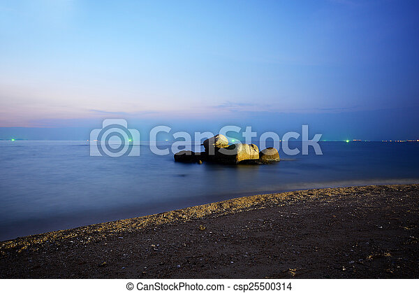 Beautiful blue sky over the sea at sunset - csp25500314