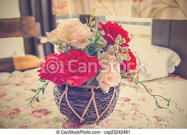 beautiful bouquet of bright flowers in basket - csp23242481