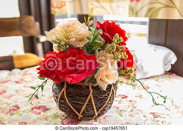 beautiful bouquet of bright flowers in basket - csp19457651