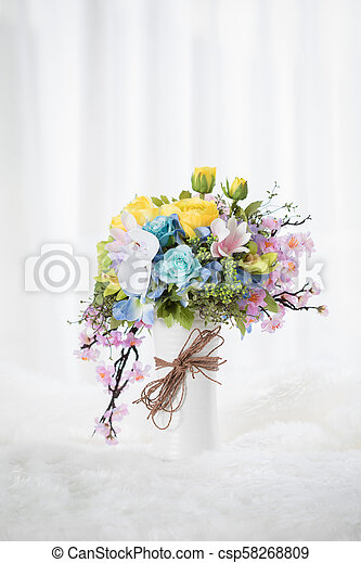 beautiful bouquet of flowers in vase - csp58268809