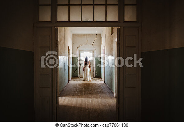 beautiful bride back with white vintage wedding dress in old abandoned manor house - csp77061130
