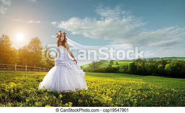 Beautiful bride in the outdoors - idyllic - csp19547901