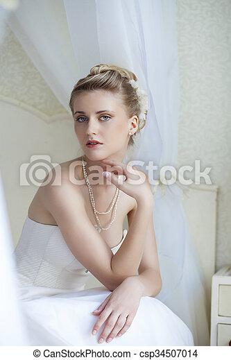 Beautiful bride in white wedding dress  - csp34507014