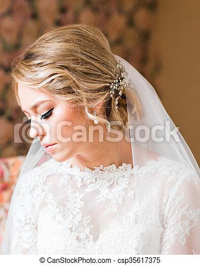 Beautiful bride in white wedding dress - csp35617375