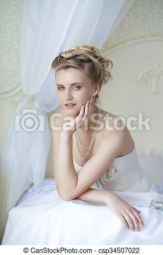 Beautiful bride in white wedding dress  - csp34507022