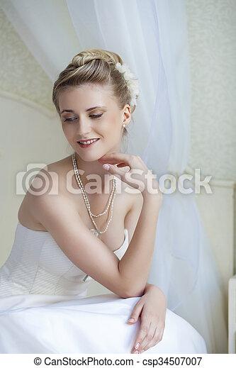 Beautiful bride in white wedding dress  - csp34507007