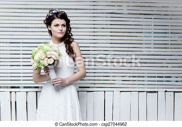 Beautiful bride with flowers - csp27044962