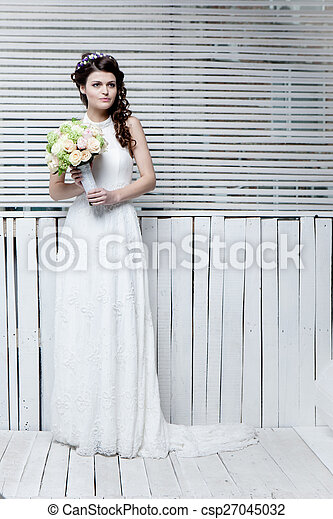 Beautiful bride with flowers - csp27045032