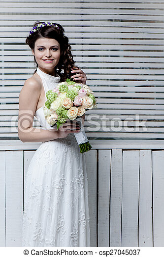 Beautiful bride with flowers - csp27045037