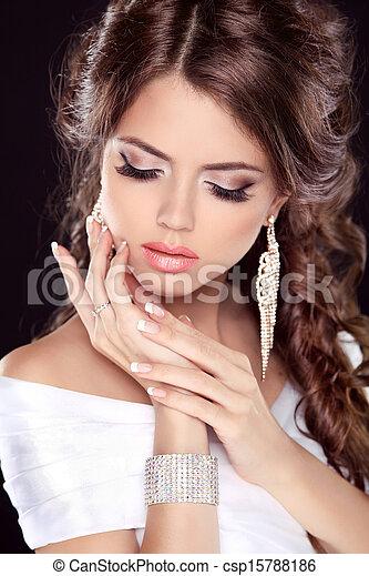 Beautiful bride woman portrait in white dress. Fashion Beauty Girl. Make up. Jewelry. Manicured nails. - csp15788186