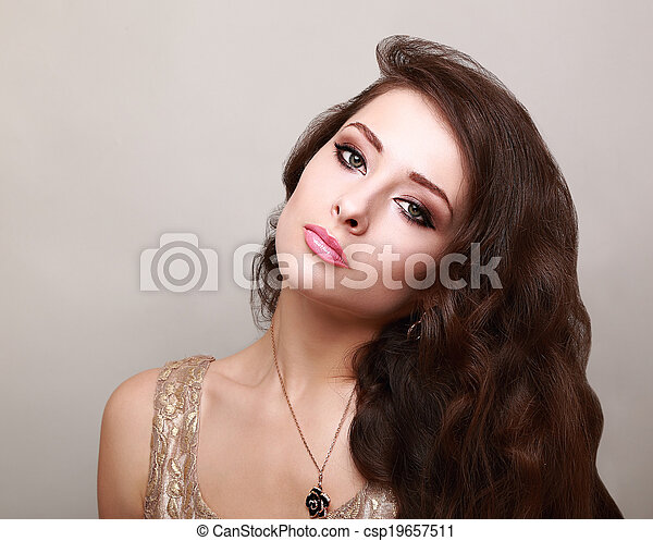 Beautiful bright makeup woman with long healthy brown hair - csp19657511