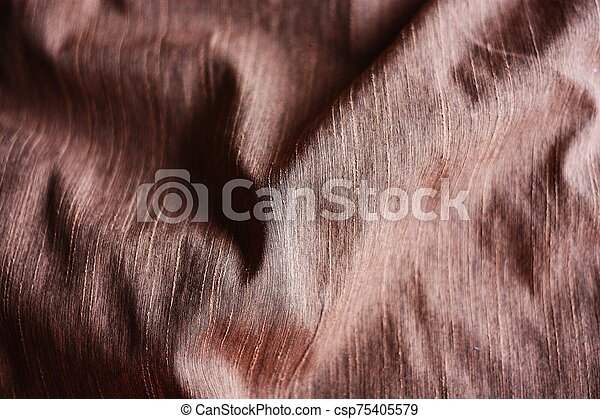 Beautiful brown fabric background close up view - csp75405579