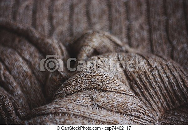 Beautiful brown knitted fabric close up view - csp74462117