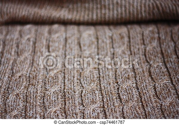 Beautiful brown knitted fabric close up view - csp74461787